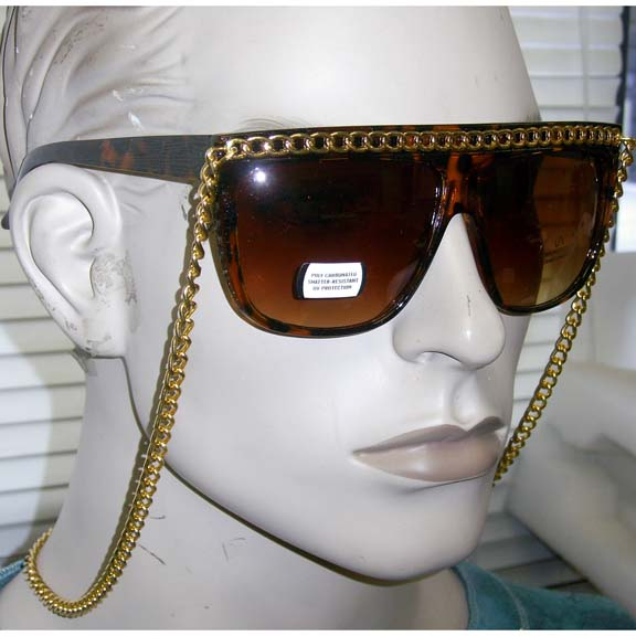 TORTOISE FRAMES WITH GOLD CHAIN ALONG TOP & CAN WEAR AROUND NECK