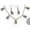 SKULL CHARMS ON NECKLACE SET BRONZE
