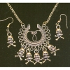 SKULLS ON HORSESHOE TYPE NECKLACE & EARRING
