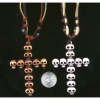 CROSS NECKLACE MADE UP OF SKULL HEADS ON ADJUSTABLE CORDS