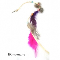 FEATHERS ON A LONG HAIR CLIP EXTENSION