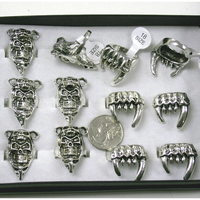 FANGS & SKULL RINGS IN A DISPLAY BOX