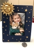 BLUE PICTURE FRAME WITH GOLD STARS AND SUN