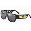 KUSH WORD BOLD  LETTERING IN ARMS BLACK SUNGLASSES