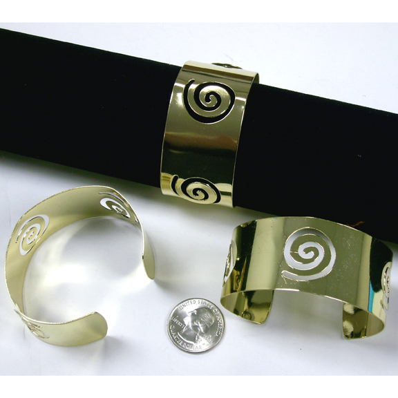 GOLD METAL BRACELETS WITH SWIRLS OPEN CUFF STYLE